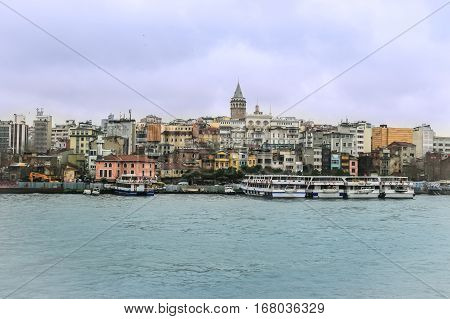 View of Galata tower and surrounding buildings on the Bosphorus River in Istanbul Turkey