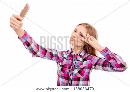 Happy Woman Showing V-sign, Pouting  And Making Selfie On Smartphone