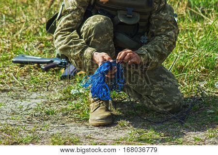 Military soldier at tactical exercises with the rope