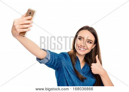 Happy Cheerful Young Woman Showing Thumb Up And Making Selfie On Smartphone