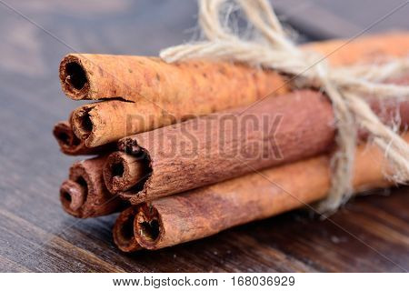 Group of cinnamon sticks on wooden table