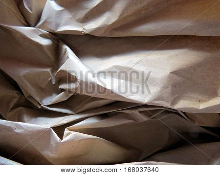 wrinkled brown kraft packing paper texture background