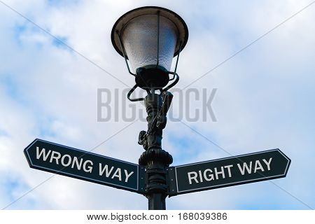 Wrong Way Versus Right Way Directional Signs On Guidepost