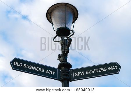 Old Business Way Versus New Business Way Directional Signs On Guidepost