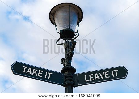 Take It Versus Leave It Directional Signs On Guidepost