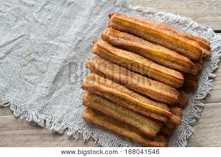 Churros - famous Spanish dessert on the wooden background