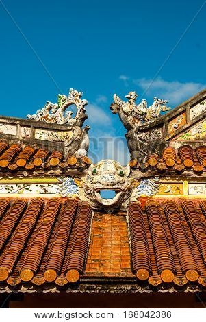 Dragon decor on pavilion roof in garden of Citadel in Hue. Vietnam.