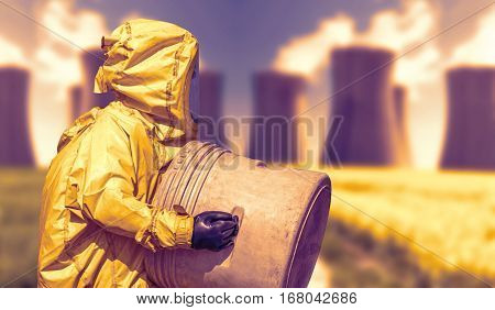 Abstract view of smoking coal power plant and men in protective hazmat suit