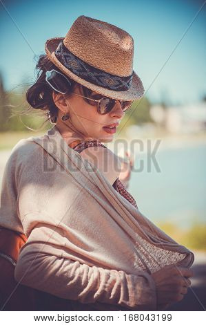 Freedom-loving Woman In Hat And Glasses