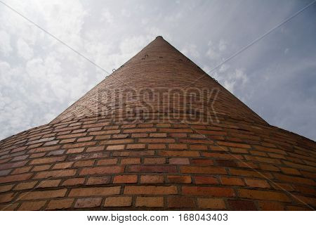 a huge industrial chimney from the frog perspective