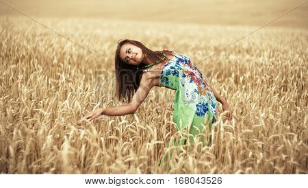 Photo of glad girl enjoying life in wheat meadow