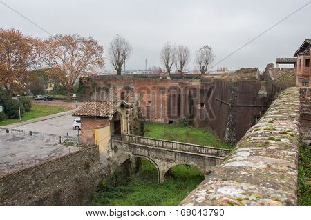 Italy Pistoia - November 27 2016: the view of the moat and bridge to the main gate of the Medici Fortress of Santa Barbara on November 27 2016 in Pistoia Italy.