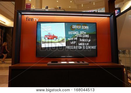 SAN FRANCISCO - OCTOBER 11: Amazon Fire TV with Hill Climb Racing playing on display on wall in San Francisco mall in California on October 11 2015. Amazon is an American international electronic commerce company. It is the world's largest online retailer