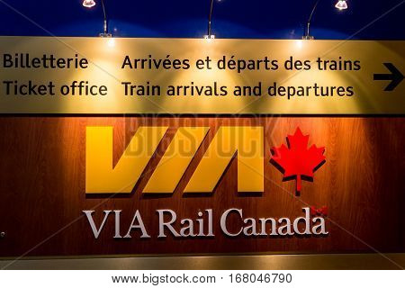 QUEBEC CITY, DECEMBER 27, 2016: Via Rail Canada departures board in Quebec City Palais Royal train station. Via Rail Canad is the main rail passenger carrier in Canada.