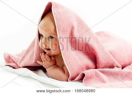 baby girl wrapped in a pink towel