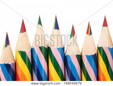 Wooden crayons perfectly sharpened placed in wavy row