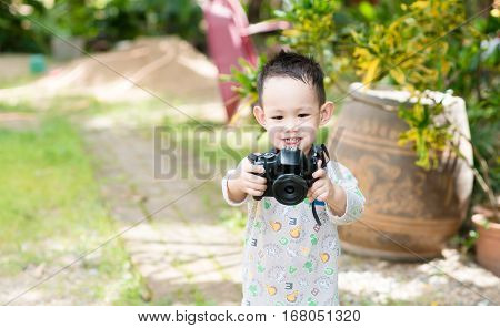 Handsome Asian Kid Take A Photo By Digital Camera
