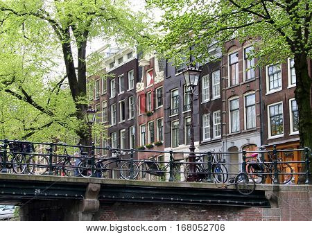 Beautiful view of Amsterdam canals in spring Netherlands