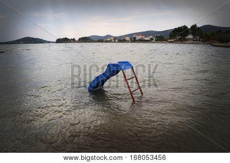 Blue water slide in the water off season