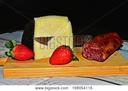 still life of  Cheese with loin and strawberries