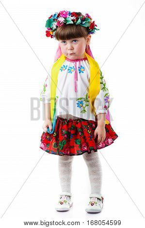 Beautiful Ukrainian baby girl costume, standing over isolated white background. Attractive Ukrainian woman wearing in traditional Ukrainian embroidery.