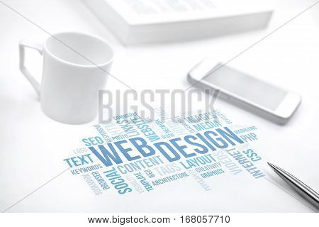 Web Design business concept word cloud print document smartphone book pen and coffee cup. Blue toned.
