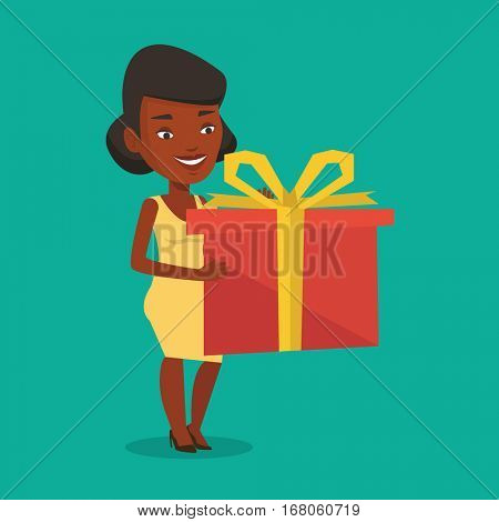 Joyful african-american woman holding a box with gift in hands. Happy woman holding gift box. Young woman standing with gift box. Girl buying a present. Vector flat design illustration. Square layout.