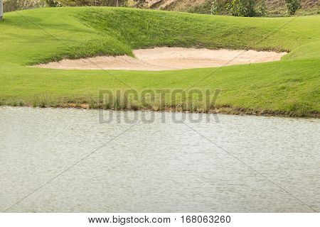 sand bunker and lake in the golf course