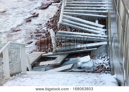 The consequences of a strong storm in the Baltic Sea as a ruined staircase on the coast.