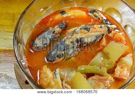 boiled mullet with mixed vegetable in spicy and sour soup on bowl