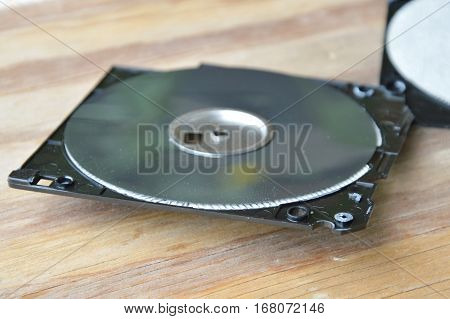 black diskette crack on the wooden board