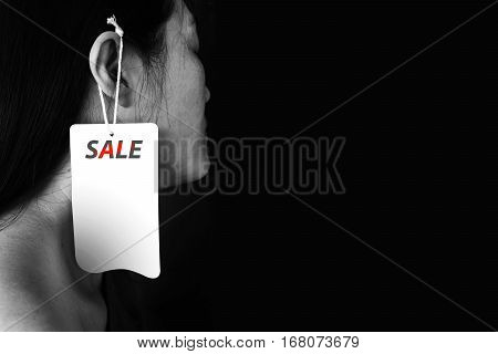 Woman With Label Hanging On Ear It (human Trafficking)