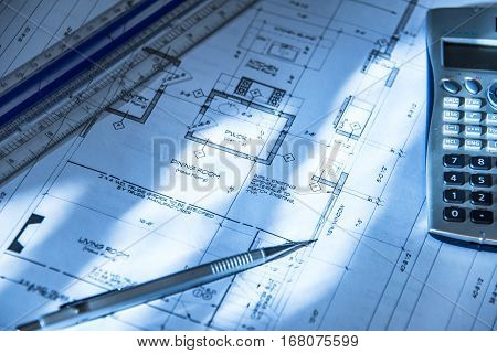 Drawings, architects interior design and drawing, designer planning new construction with architectural drawings, new structure drawings on architect's desk