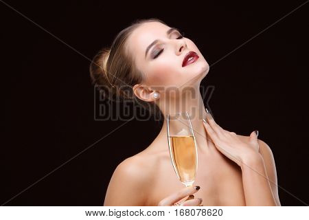 beautiful young girl  with  glass of champagne