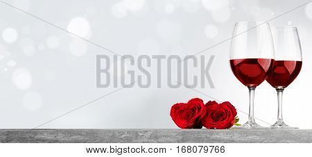 Two glasses of red wine and heart shaped roses, Valentine day
