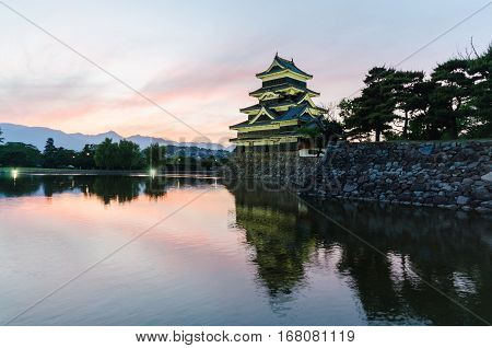 Matsumoto castle and sunset sky reflect on water ,famous public landmark in nagano japan