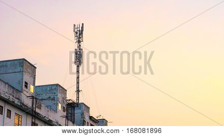 Communication cell phone and background concept - Cell phone antenna on tower with morning sky and could with copyspace