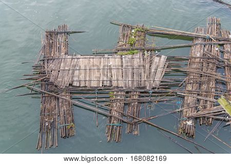 Old bamboo raft is floating on the river