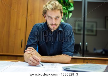 Portrait of an engineer working on a project in his office