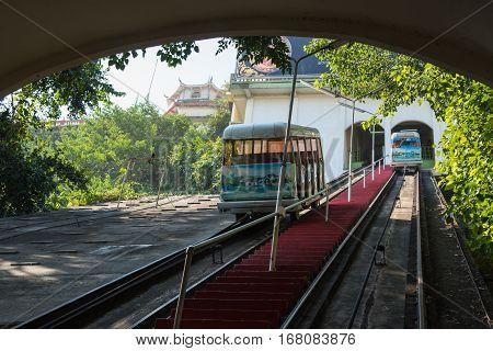 Kanchanaburi, Thailand - December 10, 2016: The popular Tram as he arrives at Wat Thum Sua - Tiger Cave Templ on December 10, 2016 in Kanchanaburi, Thailand
