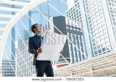 Businessman or Architect Survey or Inspection New Project Progress While Working at Constructions Site as Real Estate Development Concept.
