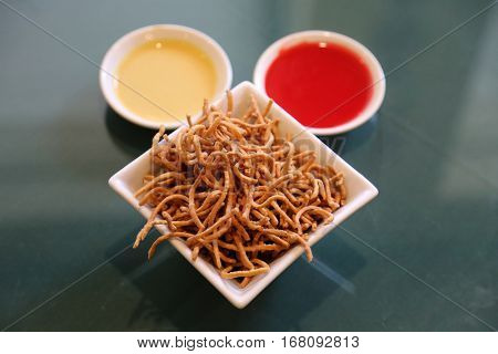 crispy noodles and sweet and sour sauce with hot mustard. Chinese food. appetizer
