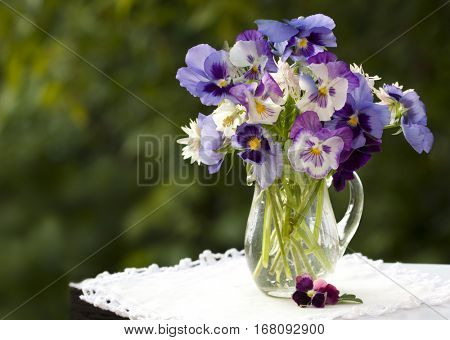 Still life with pansies, a bouquet of flowers