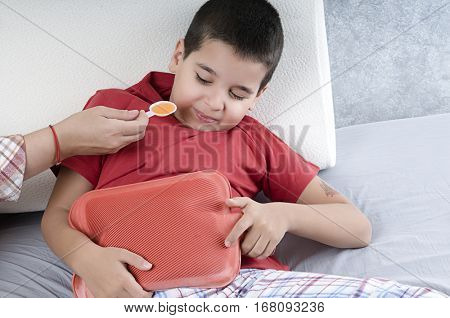 Child Unwillingly Taking Cough Syrup