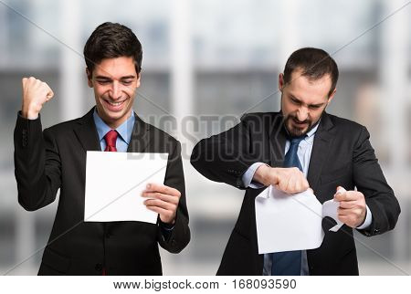 One businessman is happy of his contract, the other is not