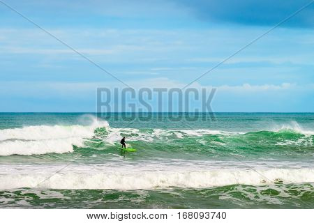 Adelaide Australia - August 14 2016: Surfer sliding the wave at Middleton Beach on a day. Middleton beach is one of the most famous places for surfing in South Australia