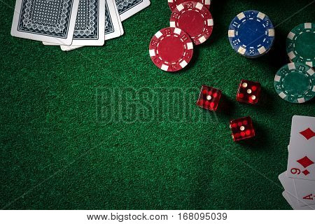 Poker Chips And Gamble Cards On Casino Green Table With Low Key Lighting Technical.