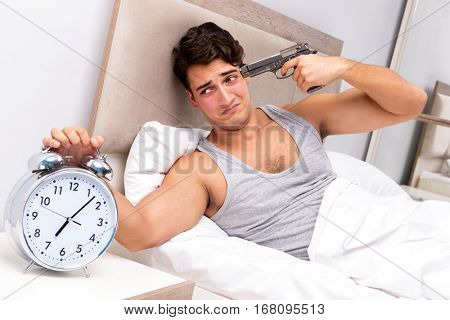 Young man having trouble waking up in the morning