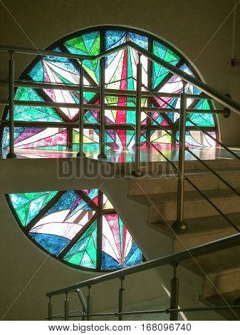 Gomel, Belarus - 31 January 2017: Stained Glass Window And Light Colored Spots On The Stairs.