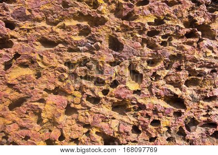 background and abstract porous texture of an old stone surface